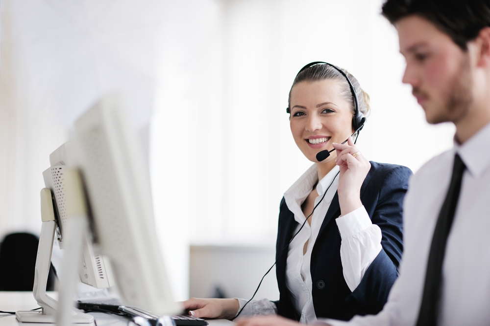 business people group with  headphones giving support in  help desk office to customers, manager giving training and education instructions-4
